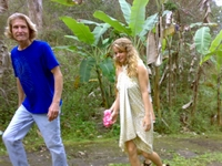 Big Isle visitor Debby Hollomon strolls through a 15 acre Mana Ke'a Gardens wellness retreat